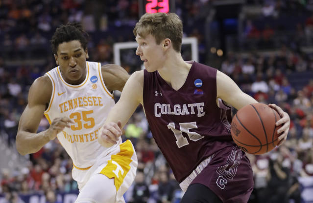 Colgate's Tucker Richardson drives past Tennessee's Yves Pons in the first half of a first-round game in the NCAA mens college basketball tournament in Columbus, Ohio, Friday, March 22, 2019. (AP Photo/Tony Dejak)