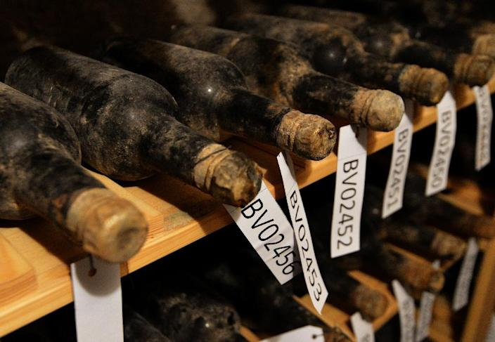 The bottles of wine sat undisturbed for decades on simple wooden shelves in Becov castle, in Western Bohemia (AFP Photo/Michal Cizek)