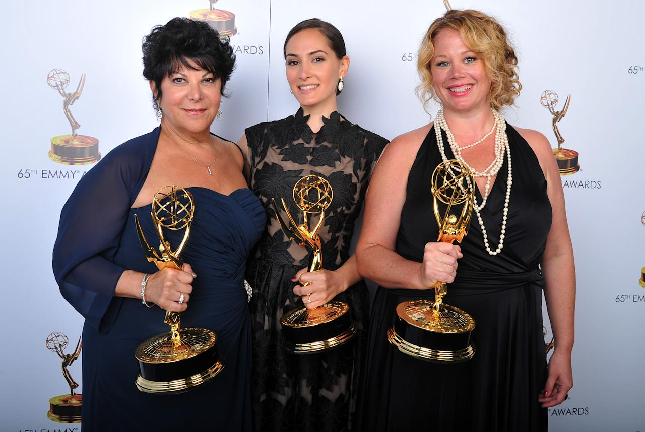 From left, Francesca Paris, Lisa Dellechiaie, and Sarah Stamp pose for a portrait at the 2013 Primetime Creative Arts Emmy Awards, on Sunday, September 15, 2013 at Nokia Theatre L.A. Live, in Los Angeles, Calif. (Photo by Vince Bucci/Invision for Academy of Television Arts & Sciences/AP Images)