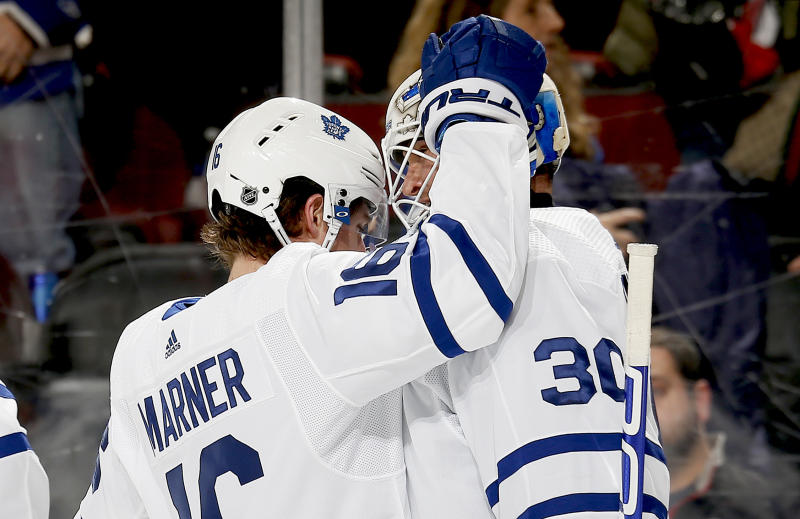 NEWARK, NJ - DECEMBER 27: Winning goaltender Michael Hutchinson #30 and Mitchell Marner #16 of the Toronto Maple Leafs react after defeating the New Jersey Devils in overtime at the Prudential Center on December 27, 2019 in Newark, New Jersey. The Leafs defeated the Devils 5-4. (Photo by Andy Marlin/NHLI via Getty Images)
