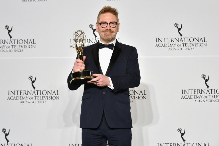"Kenneth Branagh poses with award for best performance by an actor for his work in ""Wallander"" at the 45th International Emmy Awards"