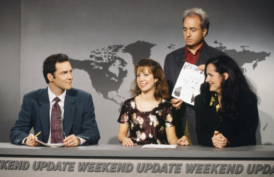 """Norm Macdonald, Cheri Oteri, Lorne Michaels and Molly Shannon during a """"Weekend Update"""" skit on SNL on Oct. 21, 1995."""