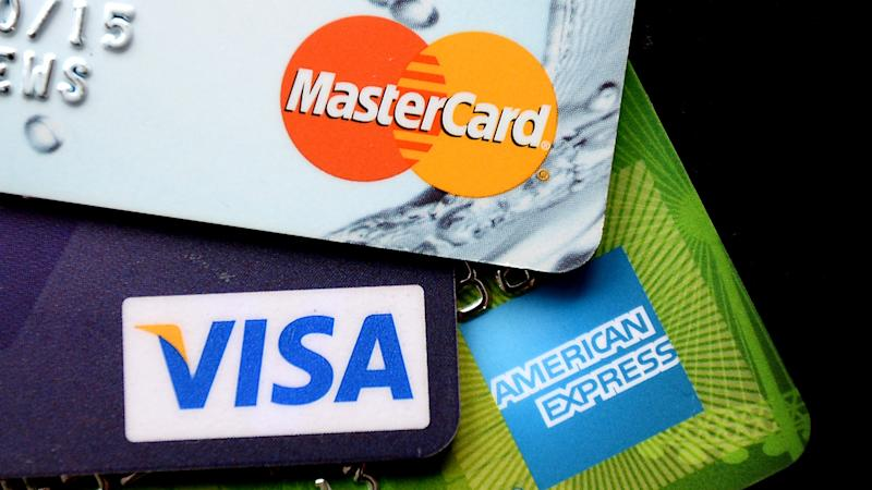 Families pay down credit card debt for first time since 2013