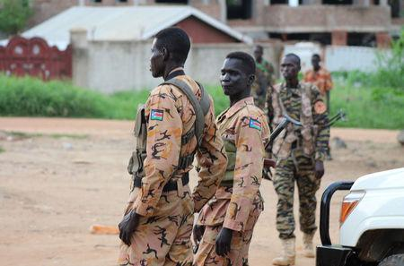 South Sudanese policemen and soldiers stand guard along a street following renewed fighting in South Sudan's capital Juba, July 10, 2016. REUTERS/Stringer