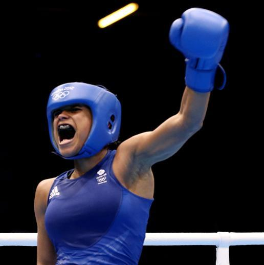 LONDON, ENGLAND - AUGUST 05: Natasha Jonas of Great Britain celebrates her victory over Quanitta Underwood of United States during the Women's Light (57-60kg) Boxing on Day 9 of the London 2012 Olympic Games at ExCeL on August 5, 2012 in London, England. (Photo by Scott Heavey/Getty Images)