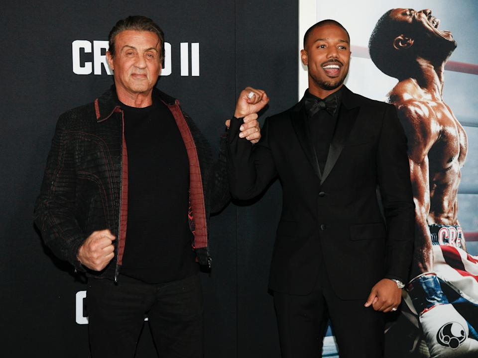 """Sylvester Stallone, left, and Michael B. Jordan attend the world premiere of """"Creed II"""" at the AMC Loews Lincoln Square on Wednesday, Nov. 14, 2018, in New York. (Photo by Andy Kropa/Invision/AP)"""