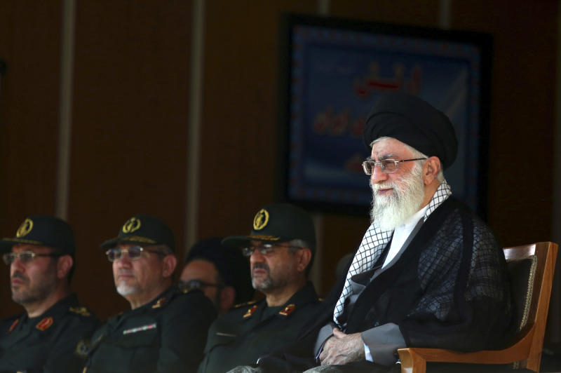 "In this picture released by an official website of the office of the Iranian supreme leader, Supreme Leader Ayatollah Ali Khamenei, right, attends a graduation ceremony of army cadets, while he is accompanied by the Revolutionary Guard commander Mohammad Ali Jafari, center, Senior Advisor to Supreme Leader in Military Affairs, Yahya Rahim Safavi, second left, and Defense Minister Hossein Dehghan, in Tehran, Iran, Saturday, Oct. 5 2013. Iran's top leader says some aspects of Hassan Rouhani's trip to New York last month were ""not appropriate,"" but has reiterated his crucial support for the president's policy of outreach to the West. The comments by Ayatollah Ali Khamenei, summarized Saturday on his website khamenei.ir, came after hard-liners criticized a 15-minute phone call made by Rouhani to President Barack Obama, a gesture aimed at ending three decades of estrangement between the two countries. (AP Photo/Office of the Iranian Supreme Leader)"