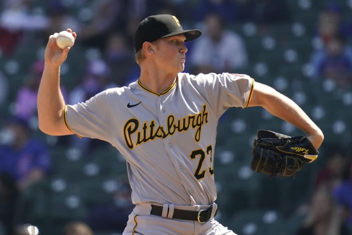 Pittsburgh Pirates starting pitcher Mitch Keller throws against the Chicago Cubs during the first inning of a baseball game in Chicago, Sunday, April 4, 2021. (AP Photo/Nam Y. Huh)