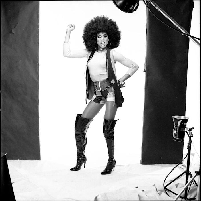 <p>Ru doing a Foxy Brown look. Check out those boots! </p>