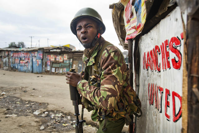 <p>A Kenyan security forces officer shout before firing a tear gas canister to chase supporters of Kenyan opposition leader and presidential candidate Raila Odinga who demonstrate in the Mathare area of Nairobi Wednesday, Aug. 9, 2017. (Photo: Jerome Delay/AP) </p>