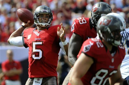 Tampa Bay Buccaneers quarterback Josh Freeman (5) throws a pass during the first quarter of an NFL football game against the San Diego Chargers Sunday, Nov. 11, 2012, in Tampa, Fla. (AP Photo/Brian Blanco)