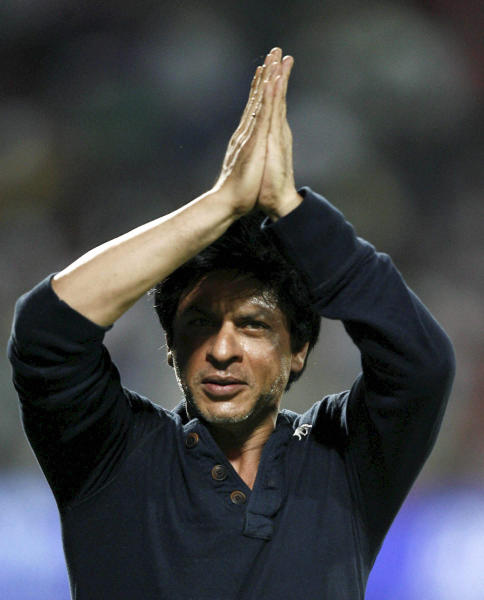 Kolkata Knight Riders' co owner and Bollywood star Shah Rukh Khan, greets the crowd as he celebrates his team's victory in their Indian Premier League (IPL) cricket playoff match against Delhi Daredevils in Pune, India, Tuesday, May 22, 2012. (AP Photo) INDIA OUT
