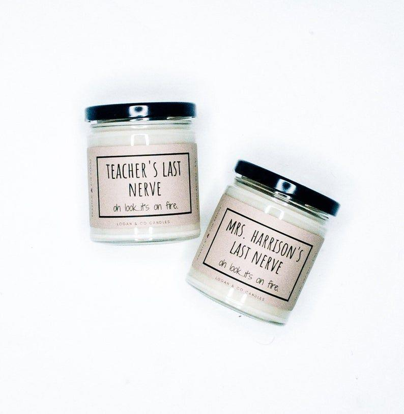 """<p><strong>LoganandCoCandles</strong></p><p>etsy.com</p><p><strong>$5.00</strong></p><p><a href=""""https://go.redirectingat.com?id=74968X1596630&url=https%3A%2F%2Fwww.etsy.com%2Flisting%2F969857931%2Fteachers-last-nerve-soy-candle&sref=https%3A%2F%2Fwww.prevention.com%2Flife%2Fg36078919%2Fteacher-gifts%2F"""" rel=""""nofollow noopener"""" target=""""_blank"""" data-ylk=""""slk:Shop Now"""" class=""""link rapid-noclick-resp"""">Shop Now</a></p><p>The gift of laughter is one of the best. This candle is bound to provide that plus <strong>a lovely scent.</strong> You can choose between Coconut & Lime, Apples & Maple Bourbon, Crème Brulee, Peppermint & Eucalyptus, Cotton & Iris, Old Library Books, Tropical Vibes, and Pumpkin Soufflé. </p>"""
