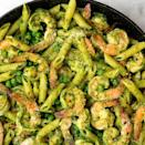 """<p>Pesto nuts will love this fresh spring combo of spinach, basil, and sweet peas.</p><p>Get the <a href=""""https://www.delish.com/uk/cooking/recipes/a35706548/spinach-pesto-penne-with-shrimp-and-peas-recipe/"""" rel=""""nofollow noopener"""" target=""""_blank"""" data-ylk=""""slk:Spinach Pesto Penne with Prawns and Peas"""" class=""""link rapid-noclick-resp"""">Spinach Pesto Penne with Prawns and Peas</a> recipe.</p>"""