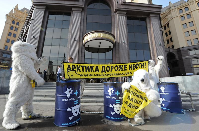 Wearing polar bear costumes Greenpeace activist take part in a staged show against Norwegian oil and gas group Statoil's planned drilling in the Arctic, outside Statoil's office in Moscow on April 25, 2013