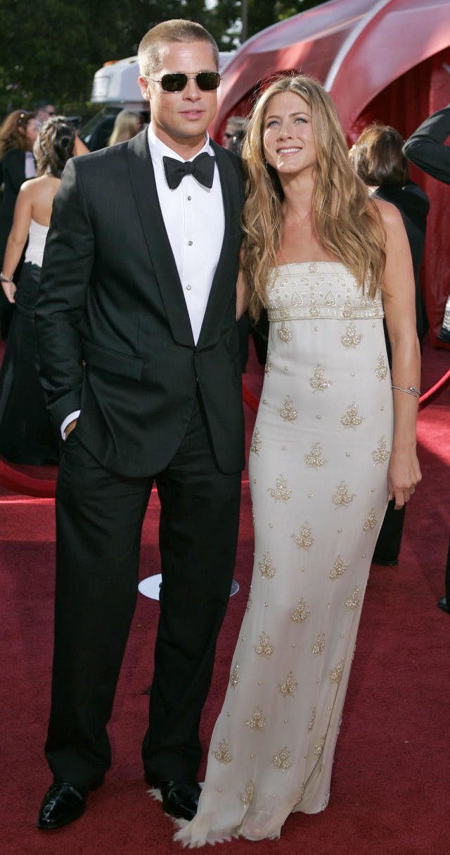 Jennifer Aniston, right, and husband Brad Pitt at the 56th Annual Primetime Emmy Awards in 2004. (AP Photo/Mark J. Terrill)