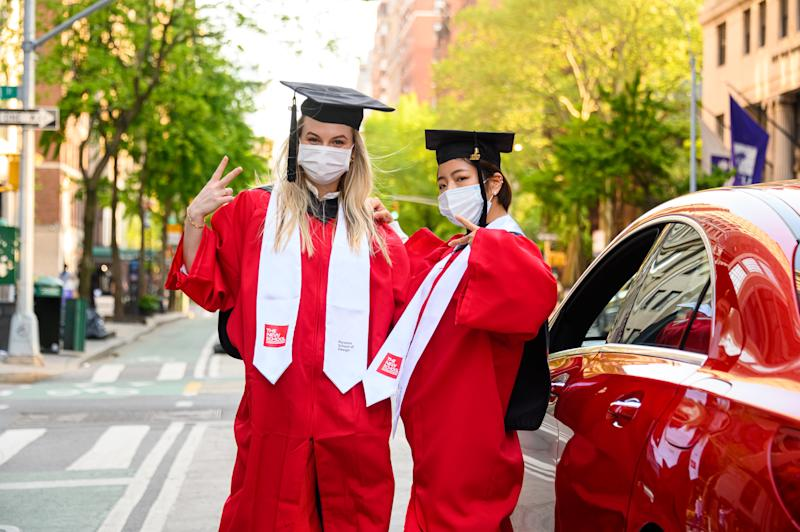 NEW YORK, NEW YORK - MAY 15: Students wear protective face masks, graduation caps and graduation gowns outside The New School during the coronavirus pandemic on May 15, 2020 in New York City. COVID-19 has spread to most countries around the world, claiming over 308,000 lives with over 4.6 million infections reported. (Photo by Noam Galai/Getty Images)