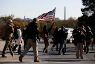 """Militia members and pro-gun rights activists participating in the """"Declaration of Restoration"""" rally march to Washington, D.C. from Arlington, Virginia"""