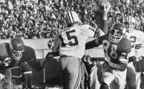 File-This Nov. 23, 1970 file photo shows Green Bay Packers quarterback Bart Starr (15) looking for a receiver as Minnesota Vikings Alan Page (88) charges him and Carl Eller (81), left, grabs his arm during the second half of an NFL game in Minneapolis, Minn. Pro Football Hall of Fame defensive tackle and retired Minnesota state supreme court justice Page has counted art collection among his many life pursuits, and the former Vikings star has two of his prized pieces up for sale through a New York auction house, each valued at more than $200,000. (AP Photo/File)