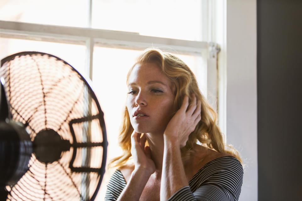 Fans don't actually cool a room, but heat it [Photo: Getty]