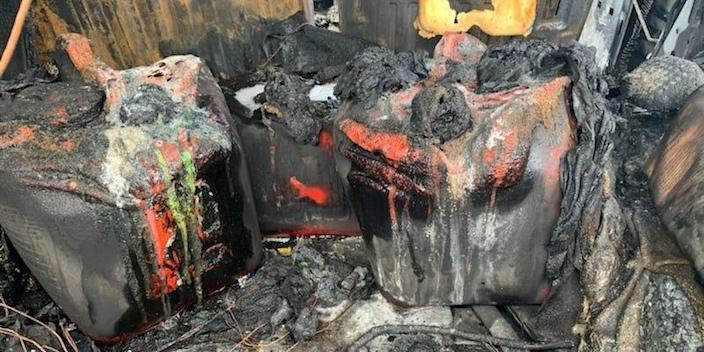 Gas tanks inside the Hummer are pictured above burned.