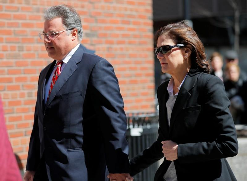FILE PHOTO:  Manuel and Elizabeth Henriquez, facing charges in a nationwide college admissions cheating scheme, enter federal court in Boston