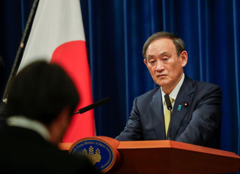 Japanese Prime Minister Yoshihide Suga speaks during a news conference in Tokyo