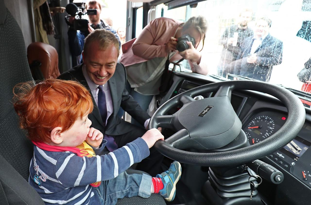 <p>Little Alex Shimmin took control of the Lib Dem battlebus as the party leader Tim Farron launched the party's Welsh campaign in Cardiff Bay. (PA Images) </p>