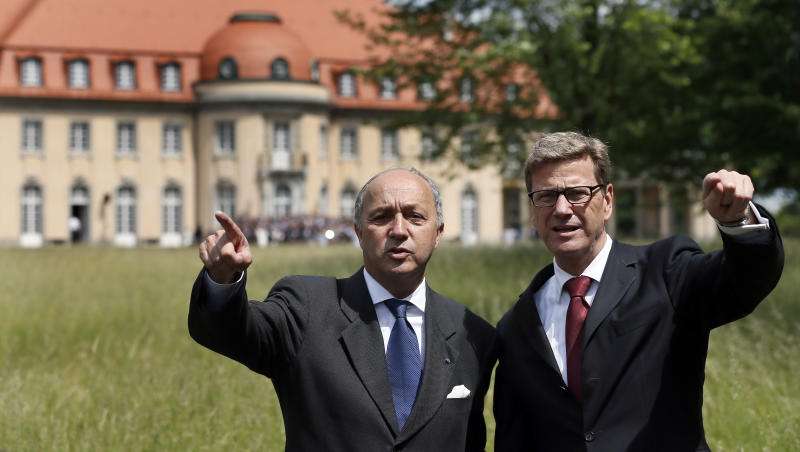 The Foreign Ministers of Germany, Guido Westerwelle, right, and France's Laurent Fabius, left, gesture in front of the guest house of the German Foreign Ministry Villa Borsig, in Berlin, Germany, Monday, June 4, 2012. (AP Photo/Michael Sohn)