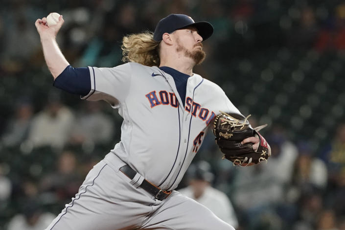 Houston Astros relief pitcher Ryne Stanek throws against the Seattle Mariners during the eighth inning of a baseball game, Monday, Aug. 30, 2021, in Seattle. (AP Photo/Ted S. Warren)