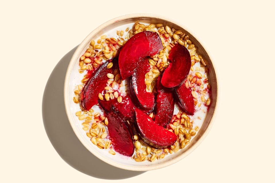 """Plums have a sweet but brightly acidic flavor, which suits them well as a topping for this savory porridge. <a href=""""https://www.epicurious.com/recipes/food/views/barley-porridge-with-honeyed-plums?mbid=synd_yahoo_rss"""" rel=""""nofollow noopener"""" target=""""_blank"""" data-ylk=""""slk:See recipe."""" class=""""link rapid-noclick-resp"""">See recipe.</a>"""