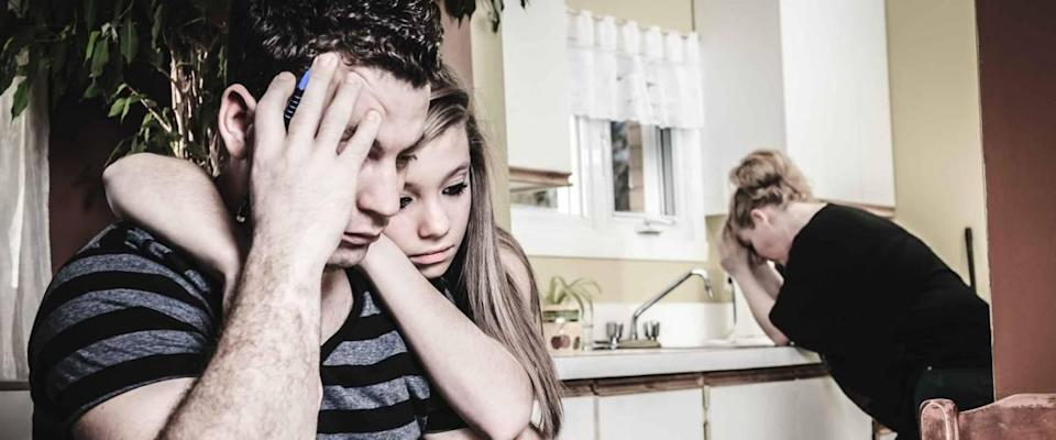 A men with financial stress at home table with teen trying to help