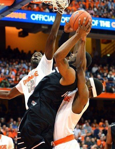 Syracuse's Baye Moussa Keita, left, and C.J. Fair, right, defend against Providence's LaDontae Henton during the first half in an NCAA college basketball game in Syracuse, N.Y., Wednesday, Feb. 20, 2013. (AP Photo/Kevin Rivoli)