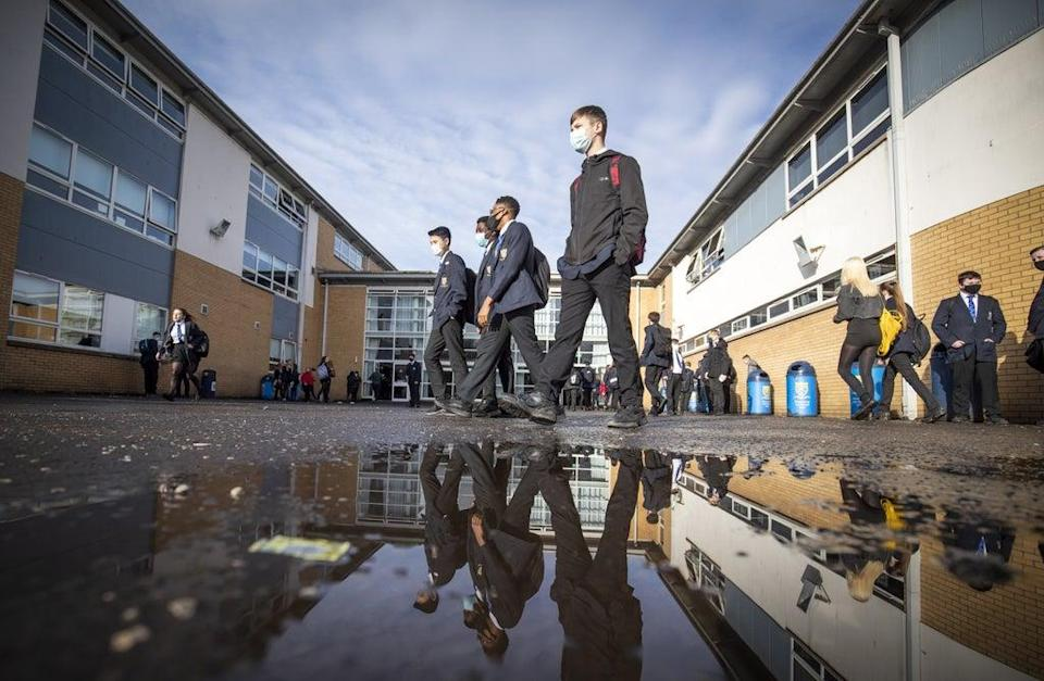 Students arriving at St Andrew's RC Secondary School in Glasgow (PA)