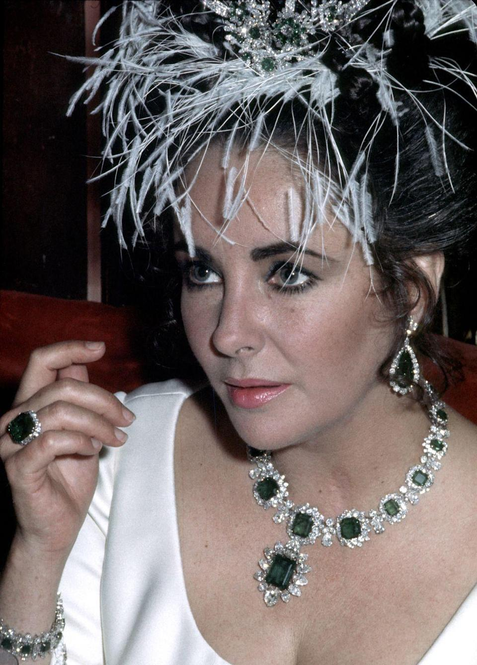 "<p>Notorious for her love of megawatt jewelry, Elizabeth Taylor's collection of diamonds, rubies, and more sold at a Christie's auction for a whopping total of $116 million, according to <em><a href=""https://www.businessinsider.com/elizabeth-taylor-jewelry-sale-auction-records-2011-12"" rel=""nofollow noopener"" target=""_blank"" data-ylk=""slk:Business Insider"" class=""link rapid-noclick-resp"">Business Insider</a></em>. One of her most famous sets of jewelry was this suite of Bulgari diamond and emerald pieces, a gift from Richard Burton. </p>"