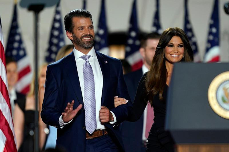 Donald Trump Jr., and his girlfriend Kimberly Guilfoyle arrive before President Donald Trump speaks from the South Lawn of the White House on the fourth day of the Republican National Convention, Thursday, Aug. 27, 2020, in Washington. (AP Photo/Evan Vucci)