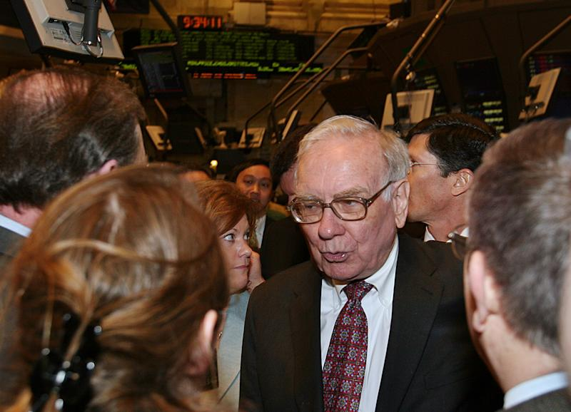 Warren Buffett, Chairman of Berkshire Hathaway, talks to reporters on the floor of the New York Stock Exchange in New York, March 20, 2006. REUTERS/Seth Wenig