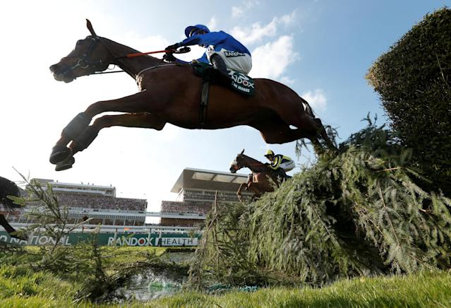 Horse Racing - Grand National Festival - Aintree Racecourse, Liverpool, Britain - April 14, 2018 Raz De Maree ridden by Robbie Power goes over a water jump during the 17:15 Randox Health Grand National Handicap Chase Action Images via Reuters/Matthew Childs