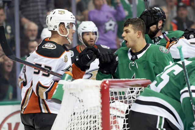 Dallas Stars defenseman Connor Carrick (5) has words with Anaheim Ducks left wing Max Comtois (53) during the second period of an NHL hockey game Saturday, Oct. 13, 2018, in Dallas. (AP Photo/Cooper Neill)