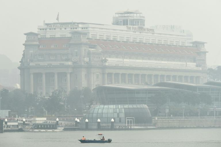 The Fullerton Hotel is blanketed with thick smog in Singapore on September 24, 2015