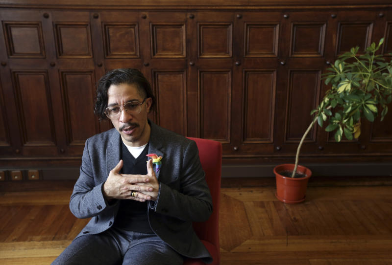 Brazilian self-exiled gay activist and former member of parliament Jean Wyllys gestures during an interview at the Portuguese parliament Wednesday, Feb. 27 2019. Wyllys was in Portugal invited to give two lectures and talk with Portuguese lawmakers about the situation of LGBT minorities in Brazil following the election of President Jair Bolsonaro. After the presidential election Wyllys left Brazil where he was living under protection following continuous death threats.(AP Photo/Armando Franca)