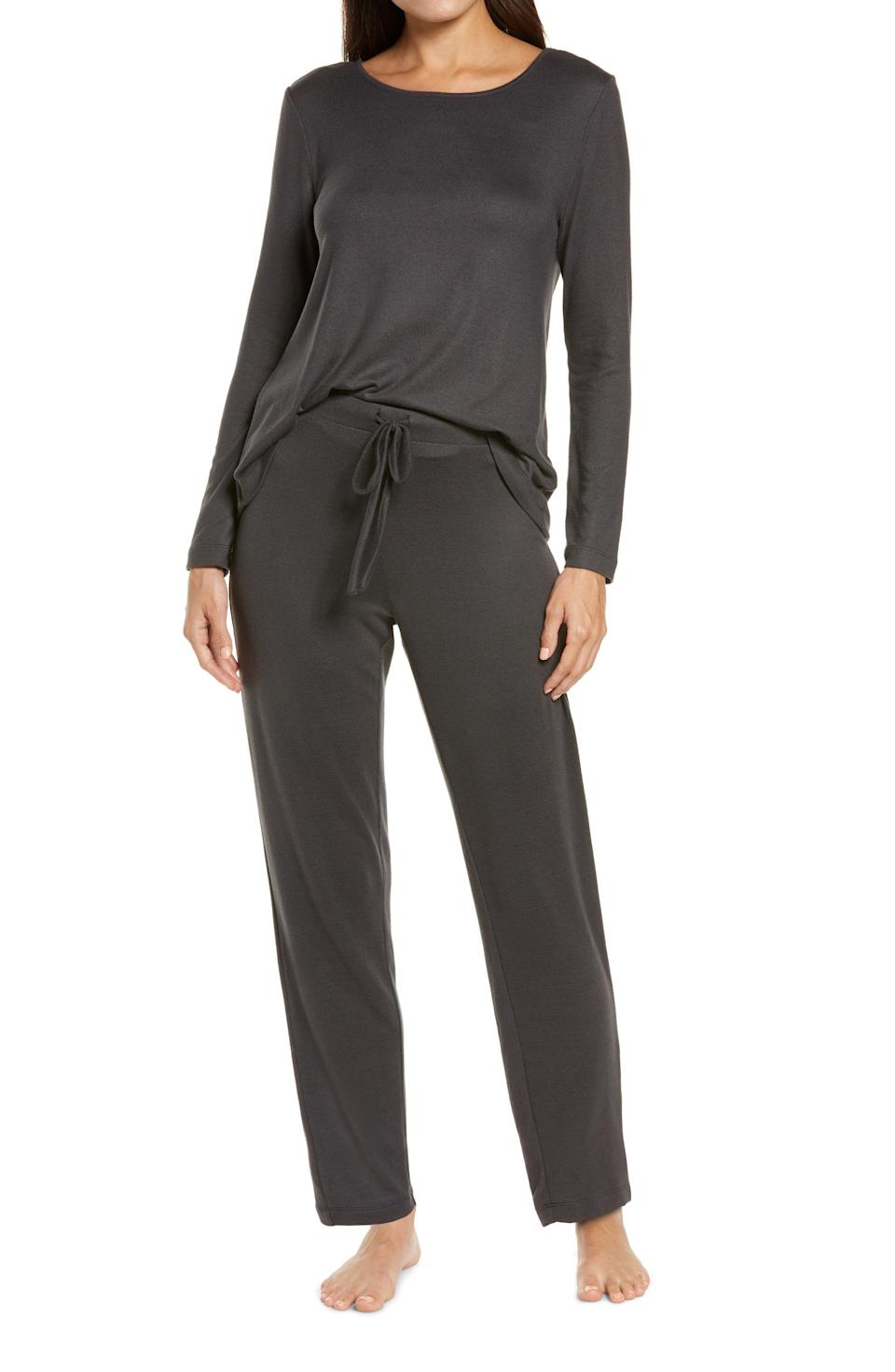 """<p><strong>Natori</strong></p><p>nordstrom.com</p><p><strong>$98.00</strong></p><p><a href=""""https://go.redirectingat.com?id=74968X1596630&url=https%3A%2F%2Fwww.nordstrom.com%2Fs%2Fnatori-fleece-pajamas%2F5763952&sref=https%3A%2F%2Fwww.prevention.com%2Flife%2Fg37664571%2Fbest-fleece-pajamas%2F"""" rel=""""nofollow noopener"""" target=""""_blank"""" data-ylk=""""slk:Shop Now"""" class=""""link rapid-noclick-resp"""">Shop Now</a></p><p>This luxe sweatsuit is one you'll never want to take off. Made of 95% polyester and 5% spandex, it's warm, yet breathable. One Nordstrom reviewer said it<strong> feels as soft as silk</strong>.</p>"""