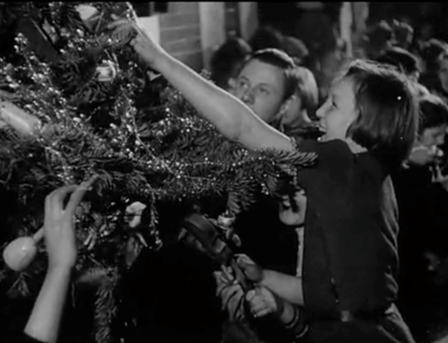"""<span class=""""caption"""">Still image from the 1940 propaganda film 'Christmas Under Fire' produced by the Crown Film Unit.</span> <span class=""""attribution""""><span class=""""source"""">BFI Archive</span></span>"""
