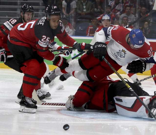Canada's Daniell Nurse checks Czech Republic's Radek Faksa, from left, during the Ice Hockey World Championships semifinal match between Canada and Czech Republic at the Ondrej Nepela Arena in Bratislava, Slovakia, Saturday, May 25, 2019. (AP Photo/Ronald Zak)