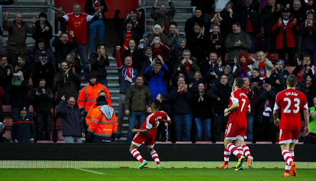 Southampton's Nathaniel Clyne, center, celebrates scoring against Burnley during their FA Cup third round soccer match at St Mary's, Southampton, England, Saturday, Jan. 4, 2014. (AP Photo/Chris Ison, PA Wire)