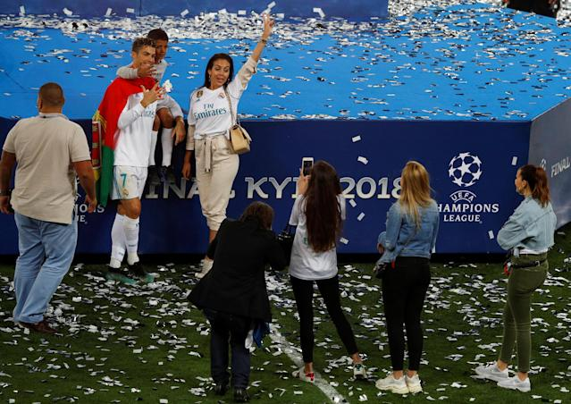 Soccer Football - Champions League Final - Real Madrid v Liverpool - NSC Olympic Stadium, Kiev, Ukraine - May 26, 2018 Real Madrid's Cristiano Ronaldo celebrates with his girlfriend Georgina Rodriguez and his son after winning the Champions League REUTERS/Phil Noble