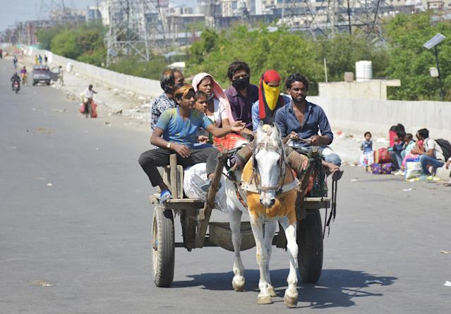 GHAZIABAD, INDIA - MARCH 29: Migrant workers head home on an animal cart during Day 5 of the 21 day nationwide lockdown imposed by PM Narendra Modi to curb the spread of coronavirus, at NH9 road, on March 29, 2020 in Ghaziabad, India. (Photo by Sakib Ali/Hindustan Times via Getty Images)