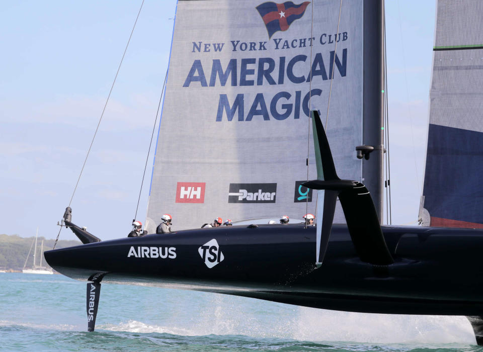 U.S. yacht American Magic competes against Britains entry in the America's Cup World Series on the Hauraki Gulf off Auckland, New Zealand, Saturday, Dec. 19, 2020. (Michael Craig/New Zealand Herald via AP)