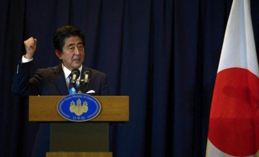 <p>Japanese Prime Minister Shinzo Abe pictured on September 7, 2013. Revised growth figures show more evidence of economic recovery, likely to clear the way for a hike in the nation's sales tax.</p>