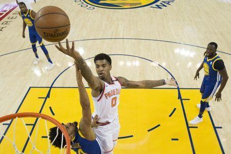 April 1, 2018; Oakland, CA, USA; Phoenix Suns forward Marquese Chriss (0) shoots the basketball against Golden State Warriors guard Quinn Cook (4) during the third quarter at Oracle Arena. The Warriors defeated the Suns 117-107. Mandatory Credit: Kyle Terada-USA TODAY Sports